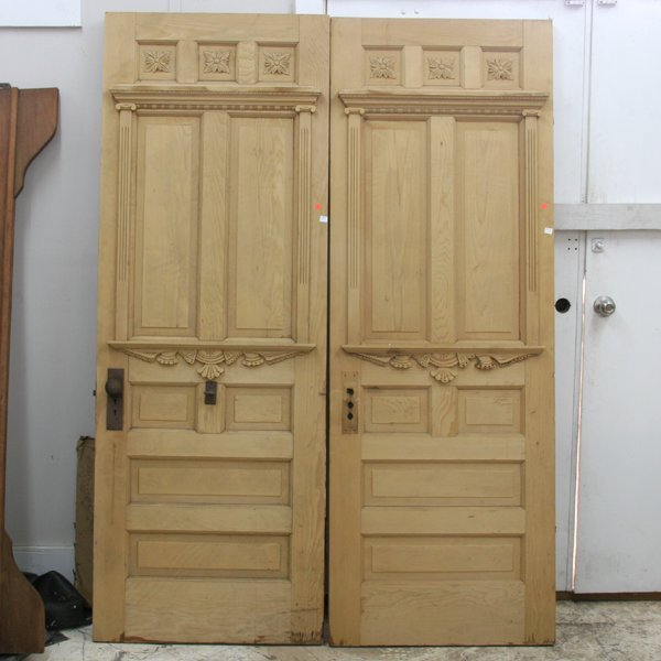 1083: Two Victorian doors, bevel panels, rosette upper