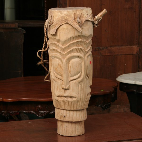 1305: African drum, carved tribal face in wood, rawhide