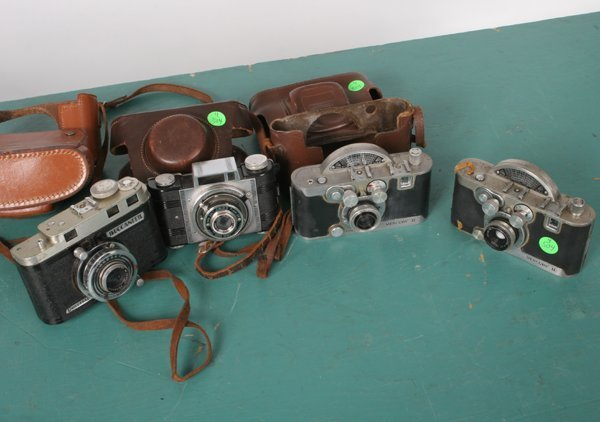 504: Lot of four half frame cameras, 1) Two Mercury II,