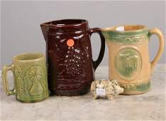 "1165: Four pieces of stoneware, 1) 8"" pitcher, grape mo"