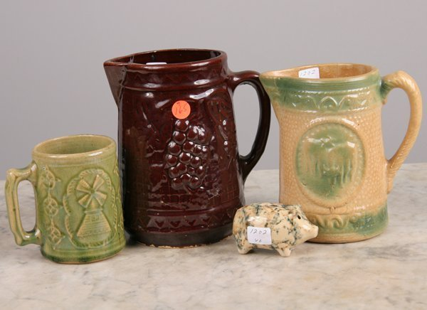 "1165: Four pieces of stoneware, 1) 8"" pitcher, grape mo"
