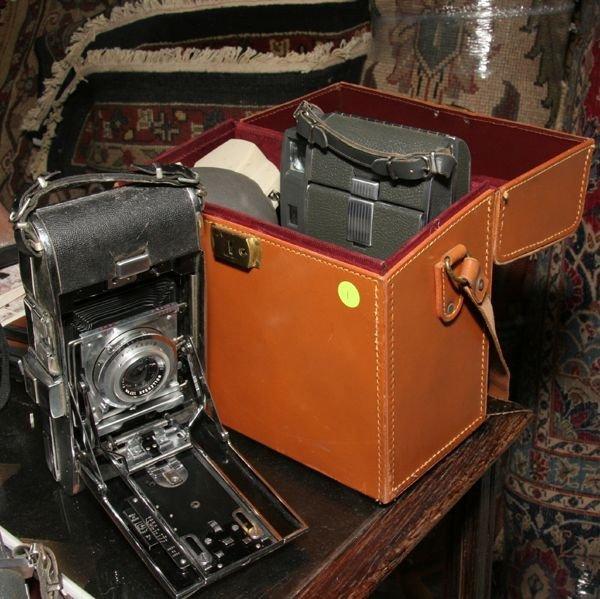 501: Two Polaroid 110A cameras, one case.
