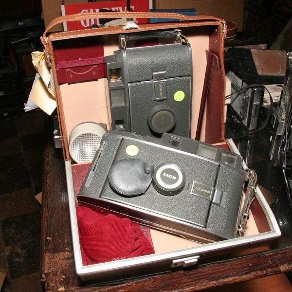 502: Two Polaroid 110B cameras, one case