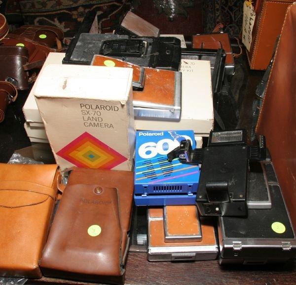 503: Ten Polaroids SX70 cameras, two accessory kits, tw