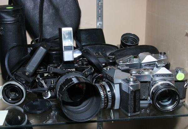 524: Lot of seven various cameras, SLR, Canon FT6, Prak