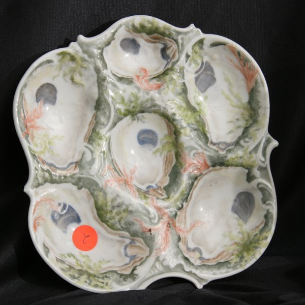 1002: Porcelain oyster plate, probably early Limoge, ha