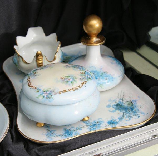 1011: Porcelain four piece dresser set, tray, covered b