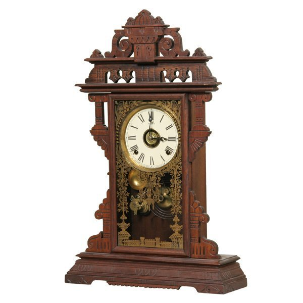 1002: Late 1800 walnut Victorian mantel clock, Welch, D