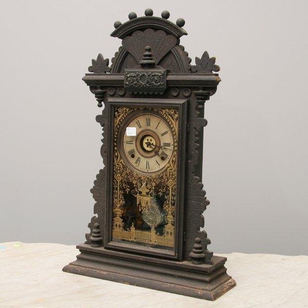1004: Late 1800 Eastlake Victorian mantel clock, solid