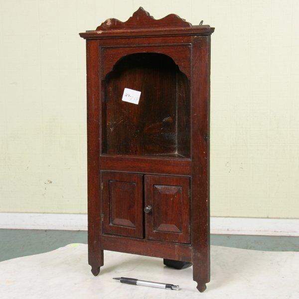 "1020: Late 19th Century child's corner cupboard, 21""t,"
