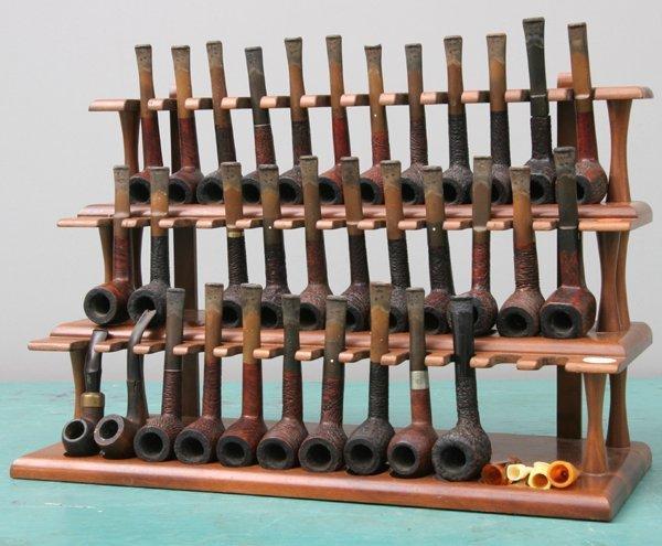 1274: Thirty-three pipes in three-tier display shelf, b