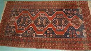 "7' x 3'8"" Antique Persian rug. Triple geometric meda"
