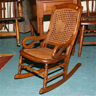 Victorian child's rocker, cane seat and back, scroll