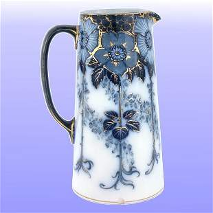 """8"""" Flow blue pitcher, bold floral and gilt band aro"""