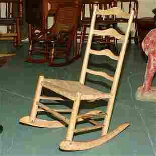 Early 19th century ladderback youth rocker, four ar