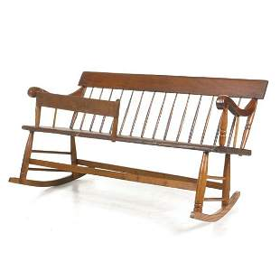 Rocking mammie bench, scrolled arms, with fence for