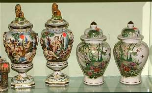 Pair urns with lid, scene of people drinking wine,