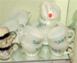 Set of ten cups and nine saucers, white, blue flor