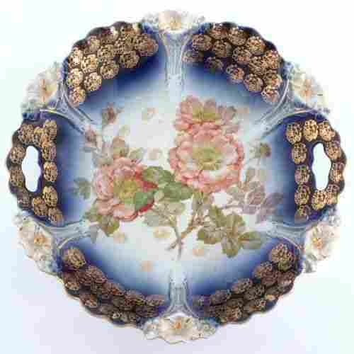 181: Lot of four platters/plate, flowing blue/handpaint