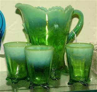 Four piece water set, green opalescent, footed lea