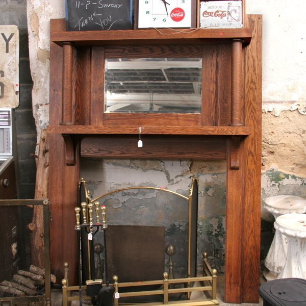 1008: Early 1900 fireplace mantel, solid oak, bracketed