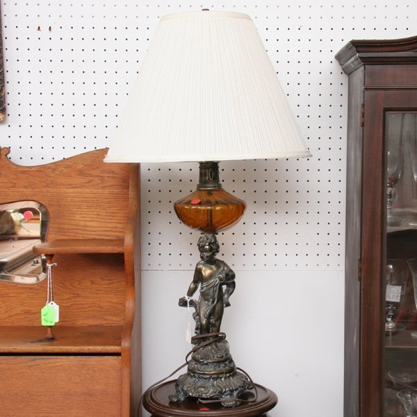 1011: Pair of contemporary table lamps, cherub pedestal