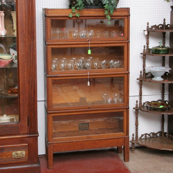 "1020: C1900 four stack bookcase, solid oak, ""The Globe-"
