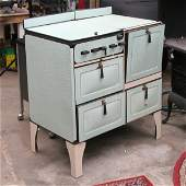 1103: Mid 1900 gas cook stove, enameled steel panels, m