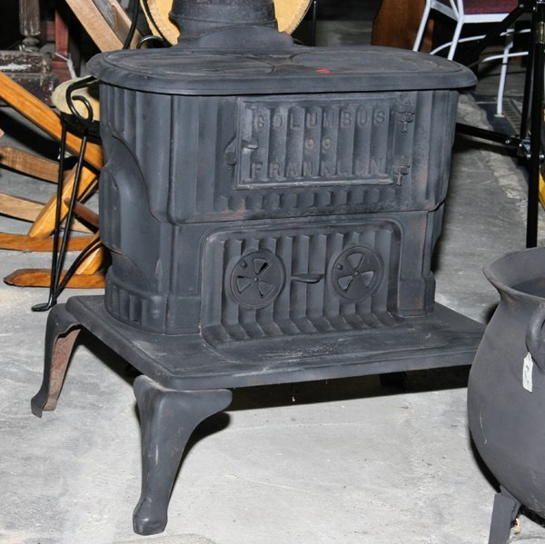 """1120: Old cast iron Franklin stove, """"Columbus 99 Frankl"""