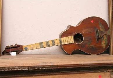 "1335: Old guitar, 37""l. As is."