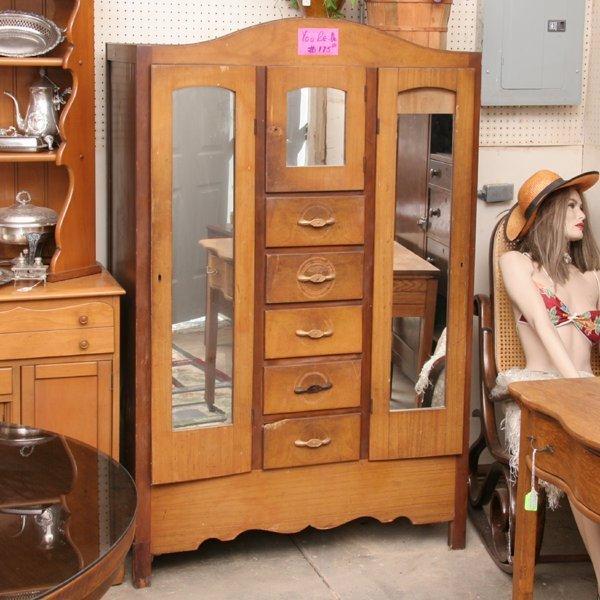 1342: Double mirrored door chifferobe, center drawers,
