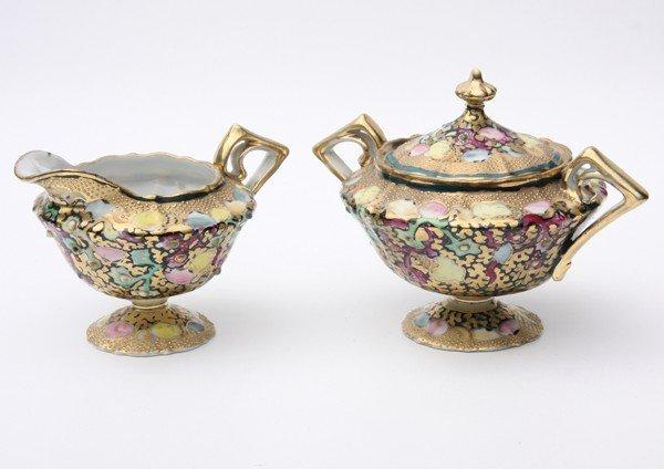 17: Porcelain pedestal creamer and covered sugar, Nippo