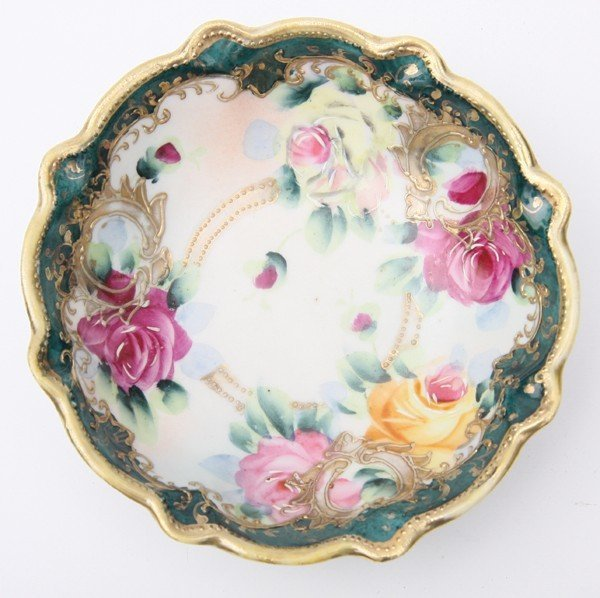 24: Lot of three pieces of porcelain, Nippon, 1) salt a