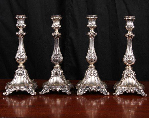 409: Set of four Rococo Victorian silverplate candlesti