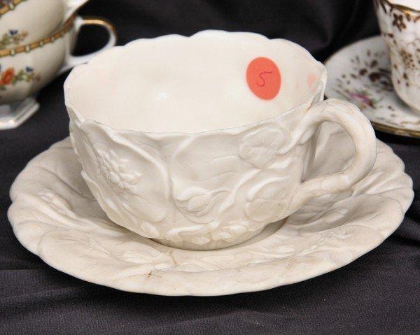 1005: Fine large parian porcelain cup and saucer, relie