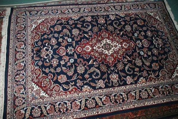 4: 6' x 9' fine Kashan rug, deep blue field, scrolled c