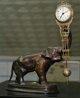 Late 19th century small swing arm mantel clock, Jun