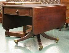 137: Early 1800 Sheraton dropleaf table. Solid mahogany