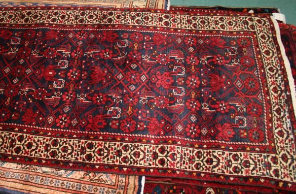 "3'5"" x 9'10"" Persian rug, dark blue field, red overall"