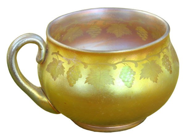 125: Tiffany teacup, gold iridescence glass, signed LCT