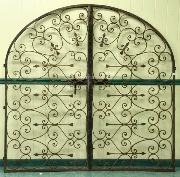"1019: Pair of early 1900 wrought iron gates, 75""w 74""t,"