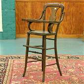 1182: Early 1900 Colonial Revival high chair, solid oak