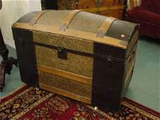 1365: Circa 1900 camel back trunk, floral embossed tin,