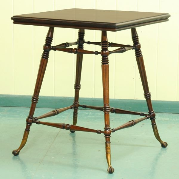 1008: Late 1800's center table in the manor of G. Hunzi