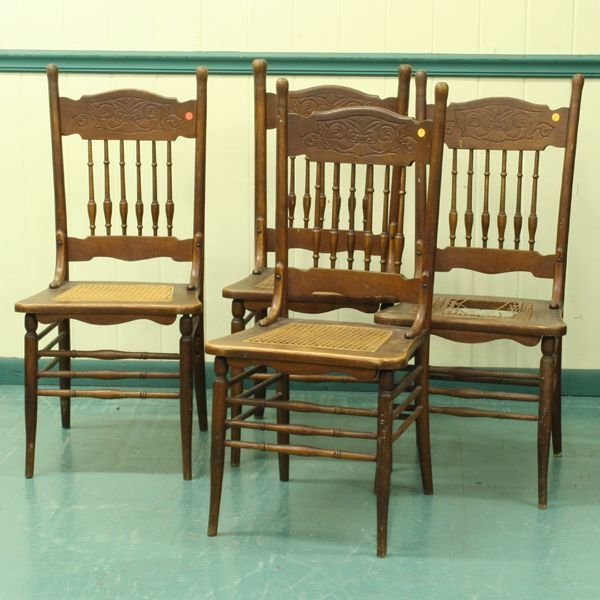 1021: Set of four circa 1900 pressed back dining chairs