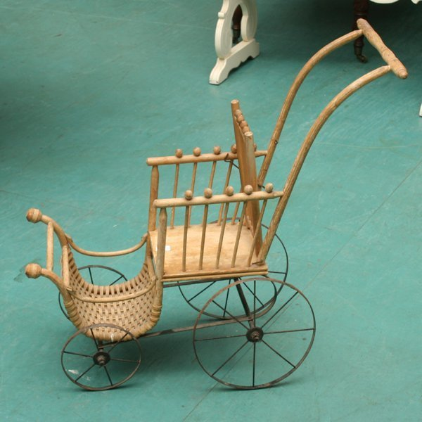 1009: Victorian doll buggy, stick and ball sides, wicke