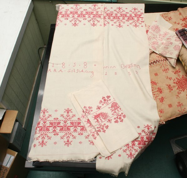 1018: Lot of three pieces of needlework, red cross stit