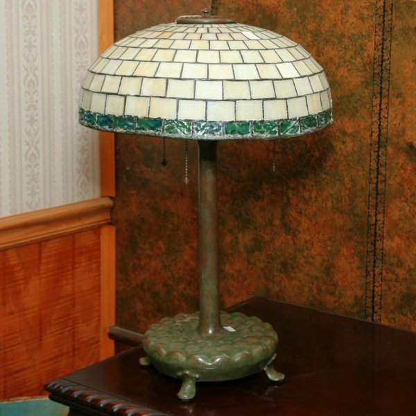 218: Leaded glass lamp, shade and base signed and numbe