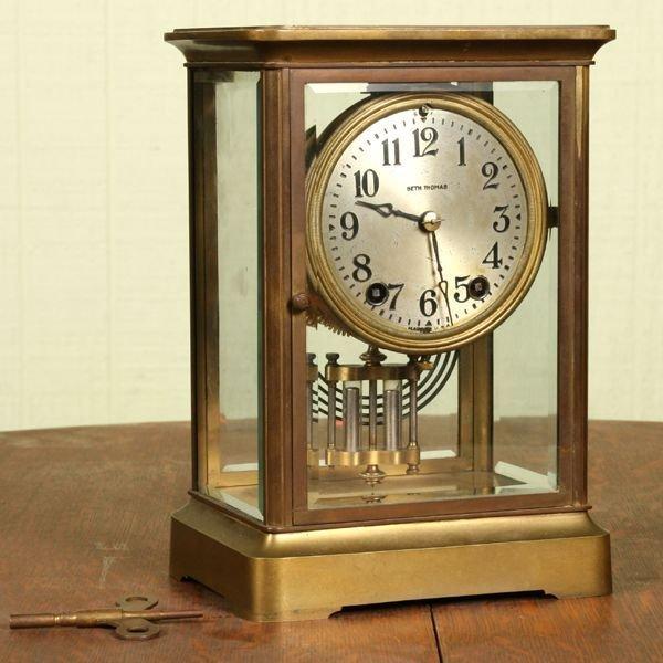 1009: Circa 1900 brass and crystal mantle regulator clo