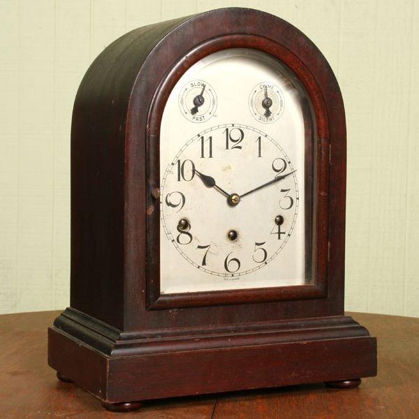 1014: Early 1900 bracket style mantle clock, mahogany,